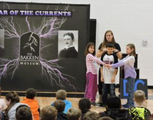 Children demonstrating electricity experiment for Bakken program